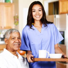 Caregiver giving food to elder