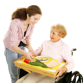 Caregiver serving food to elder