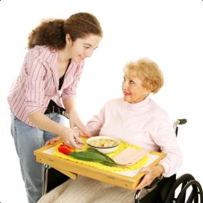 Caregiver serving food to elder