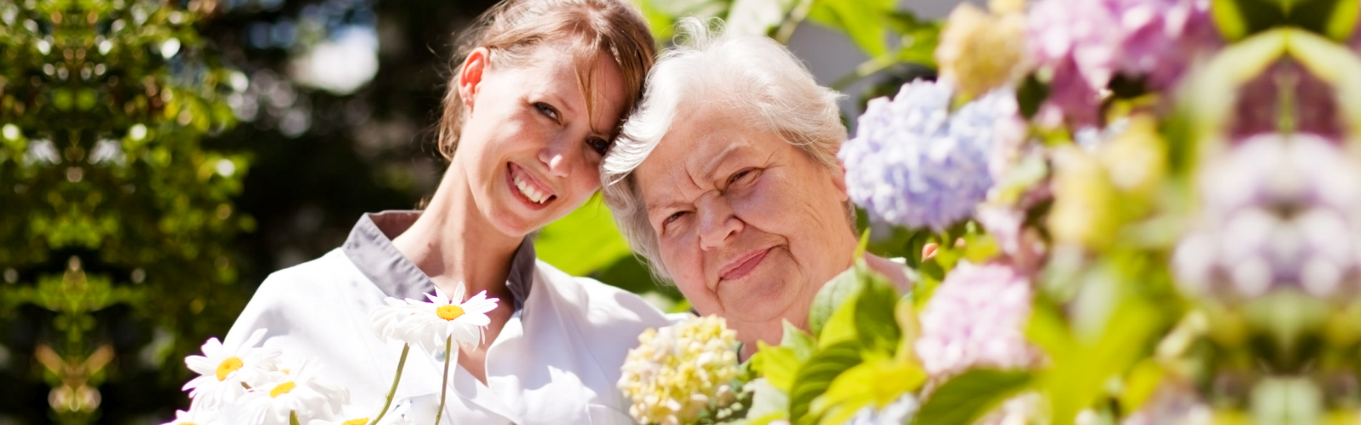Caregiver and elder in the garden
