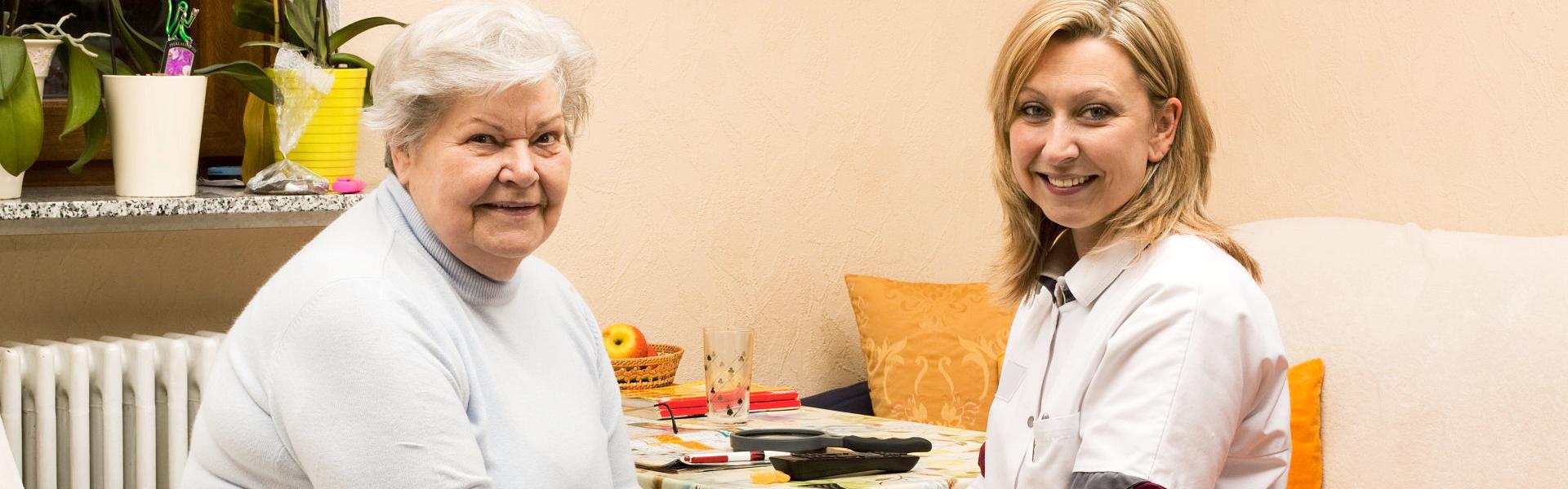 Caregiver and elder doing something
